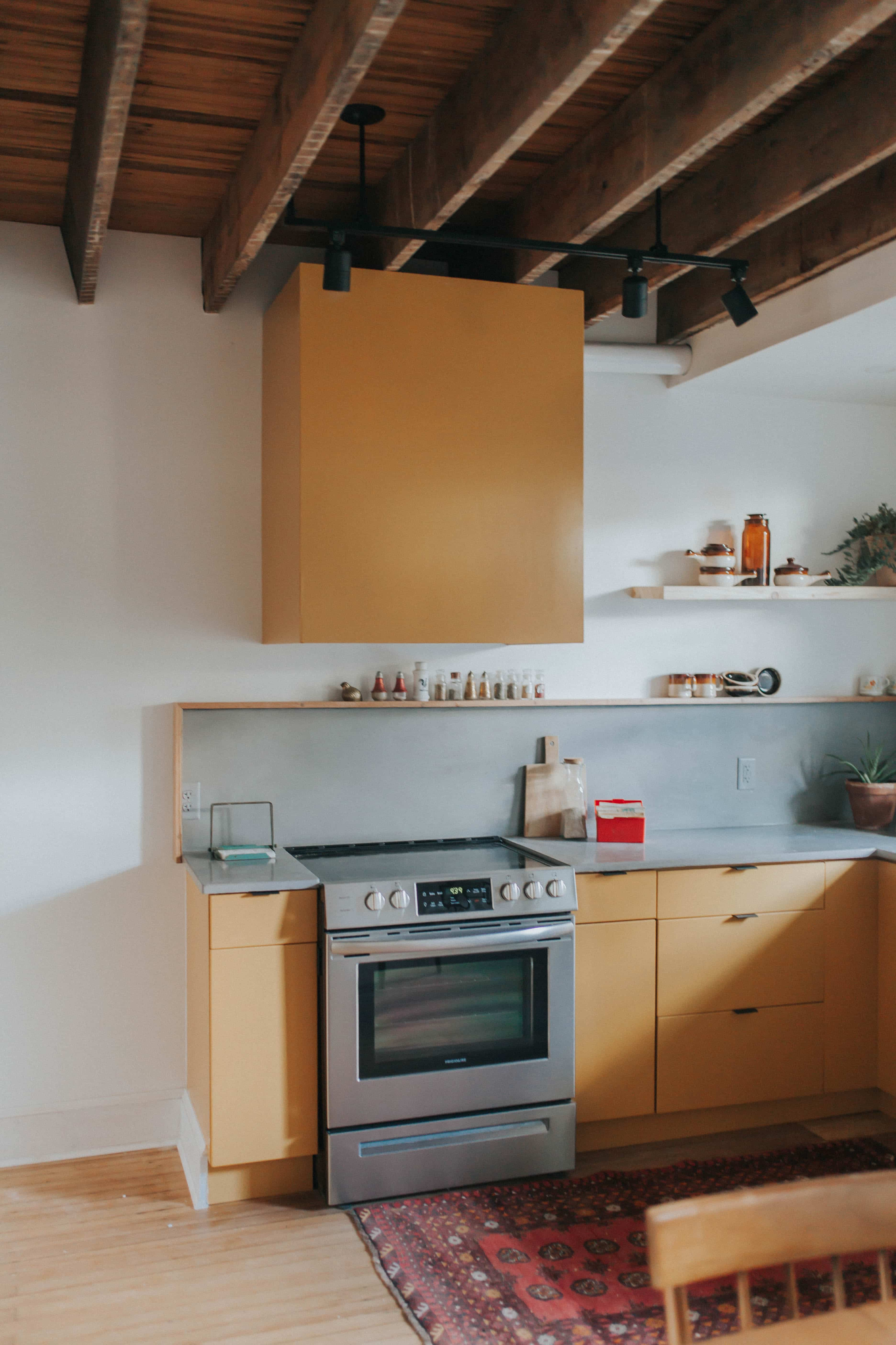 Retro kitchen with concrete countertops and Persian rug